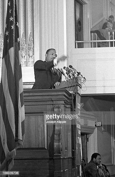 Profile view of American Civil Rights leader Dr Martin Luther King Jr as he speaks from a lecturn at the New York Avenue Presbyterian Church...