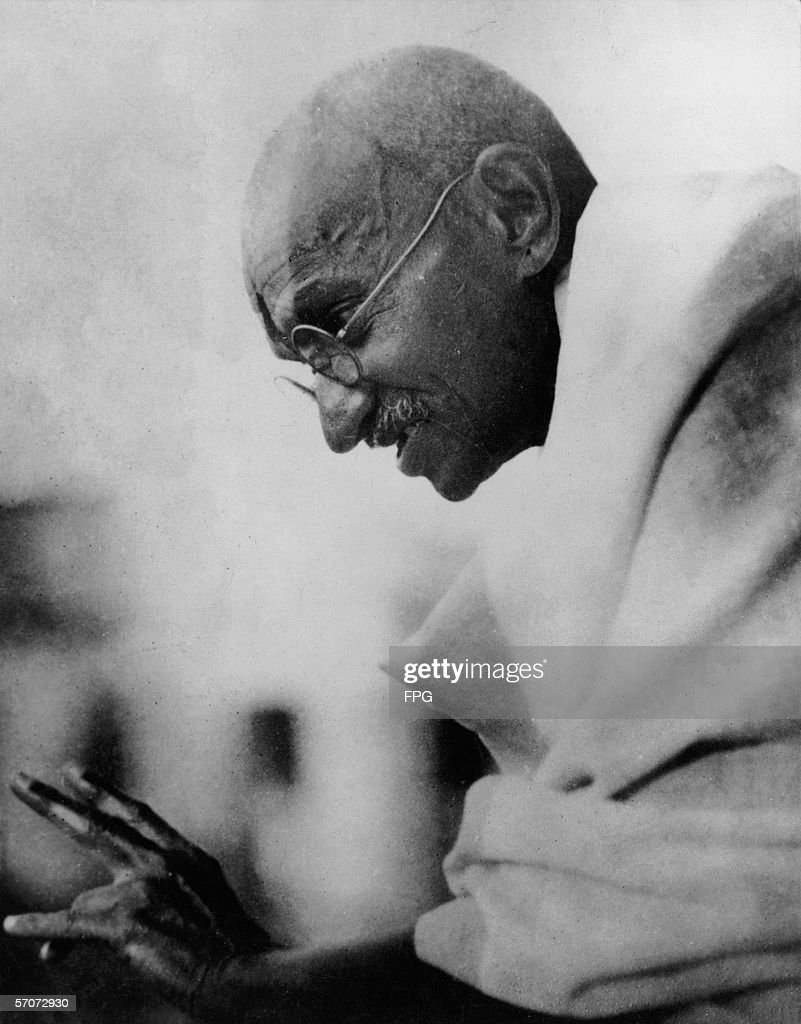 Profile view of Indian political and religious leader and pacificist Mohandas Gandhi as he gestures during a speech mid 1940s