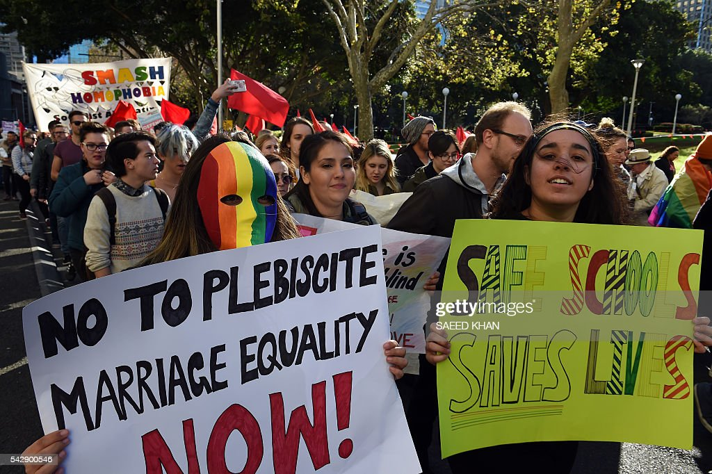 Pro-gay marriage supporters attend a rally and march in Sydney on June 25, 2016. Hundreds of supporters of gay marriage marched through the streets of the central business district of Sydney for their rights. / AFP / SAEED
