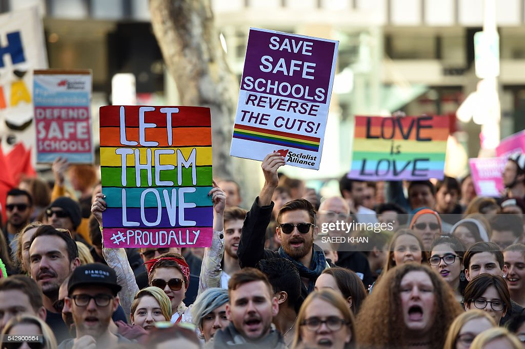 Pro-gay marriage supporters attend a rally in Sydney on June 25, 2016. Hundreds of supporters of gay marriage marched through the streets of the central business district of Sydney for their rights. / AFP / SAEED