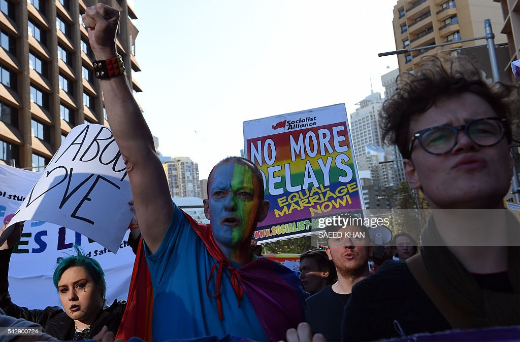 Pro-gay marriage supporters shout for their rights during a rally in Sydney on June 25, 2016. Hundreds of supporters of gay marriage marched through the streets of the central business district of Sydney for their rights. / AFP / SAEED