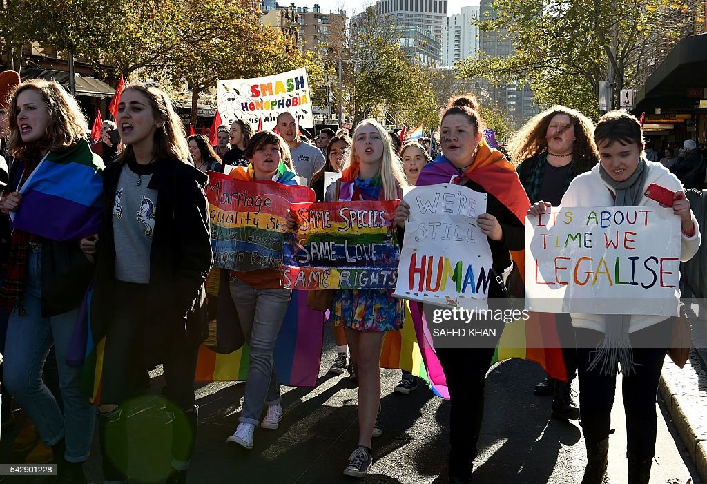 Pro-gay marriage supporters shout slogans calling for more rights during a rally in Sydney on June 25, 2016. Hundreds of supporters of gay marriage marched through the streets of the central business district of Sydney for their rights. / AFP / SAEED