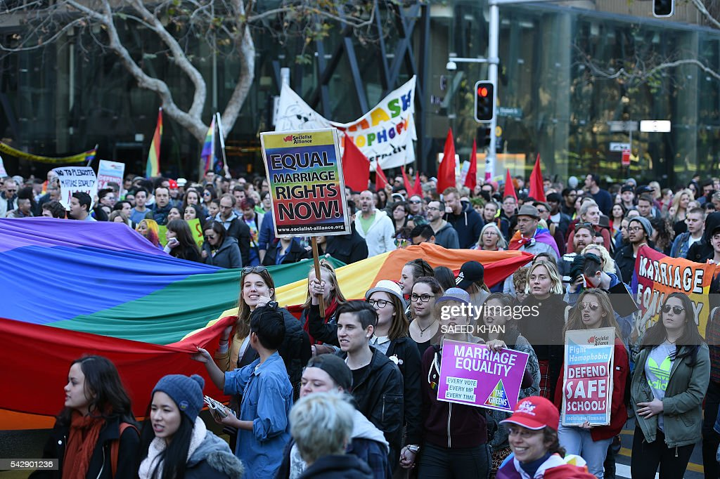 Pro-gay marriage suppoters march in a rally for their rights in Sydney on June 25, 2016. Hundreds of supporters of gay marriage marched through the streets of the central business district of Sydney for their rights. / AFP / SAEED