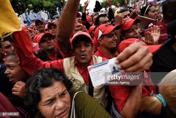 Progovernment activists march during a rally to support Venezuelan President Nicolas Maduro and oppose US President Donald Trump in Caracas on August...