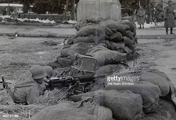 A progovernment army soldier prepare for rebel attack during the February 26 Incident at Hibiya Park on February 26 1936 in Tokyo Japan