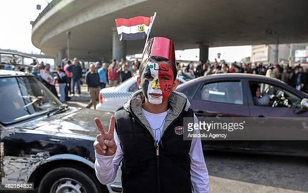 Progovernment Egyptian shows victory sign during a counter protest as another group of Egyptians called themselves 'anticoup' stage demonstration to...