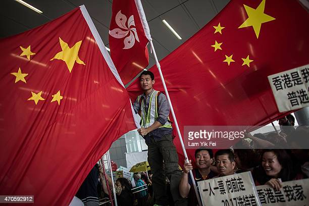 Progovernment protesters wave Chinese national flags outside the Legislative Council on April 22 2015 in Hong Kong Hong Kong The government was set...