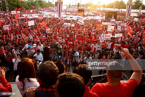 Progovernment 'red shirt' leaders speak to their supporters during a large rally on the outskirts of Bangkok The government supporters massed on the...