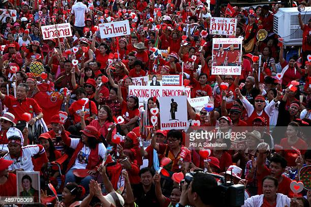 Progovernment 'red shirts' hold their slogans during a large rally on the outskirts of Bangkok The government supporters massed on the outskirts of...