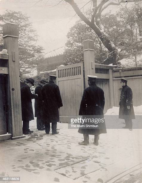 Progovernment soldiers stand guard the house of Minseito preisndet Chuji Machida during the February 26 Incident on February 26 1936 in Tokyo Japan