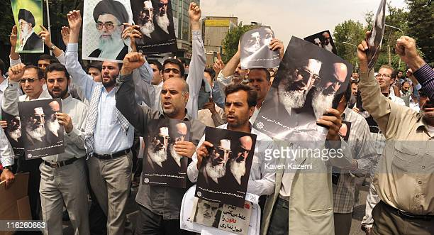 Progovernment supporters carrying posters of Islamic Republic leaders march outside Tehran university to show their loyalty to Islamic Republic...