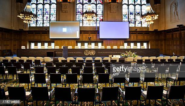Program booklets are placed on seats in the plenary hall of the Peace Palace in The Hague on August 27 one day before the celebration of its 100th...