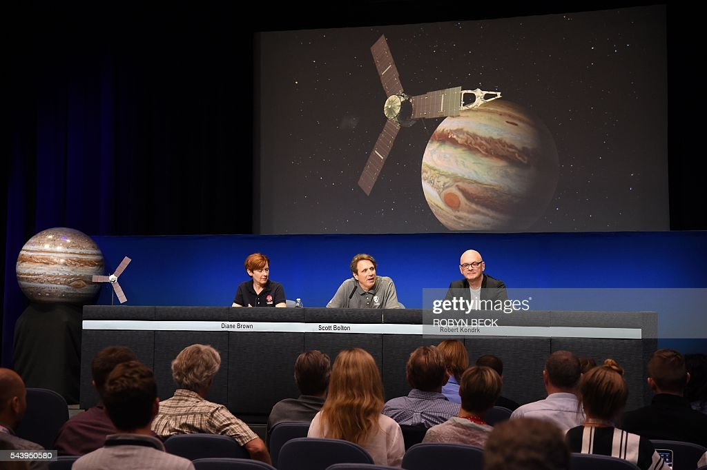 Program Executive Diane Brown (L), Juno Mission Principal Investigator Scott Bolton (C) and Robert Kondrk (R), Apple vice president for Content and Media Apps, attend a press conference at the Jet Propulsion Laboratory (JPL) in Pasadena, California, June 30, 2016 to announce 'Destination: Juno,' a collaboration between NASA and Apple to bring 'exploratory' music inspired by space from artists such as Brad Paisley, Corinne Bailey Rae, GZA, Jim James featuring Lydia Tyrell, Trent Reznor & Atticus Ross, Weezer and Zoé to Apple Music and iTunes listeners. The Juno spacecraft is scheduled to enter Jupiter's orbit on July 4, 2016 after a five years voyage to the fifth planet from the sun. / AFP / Robyn Beck