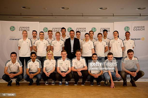 Program participants pose with assistant coach HansDieter Flick during the launch of the DFB and Commerzbank Junior Coach Program on April 30 2013 in...