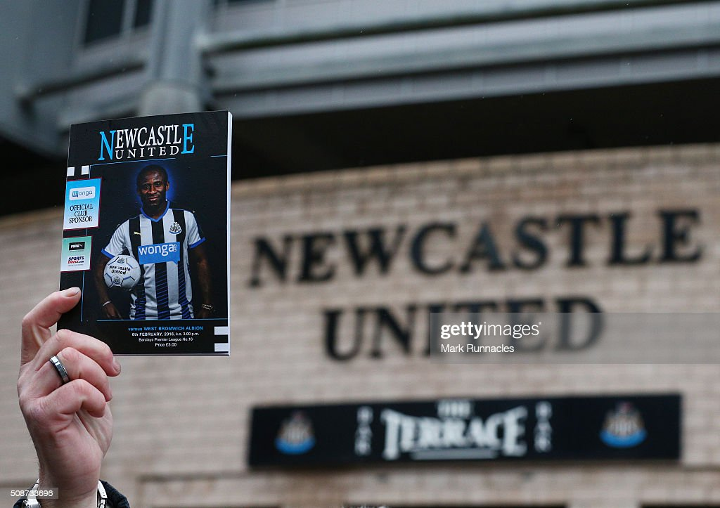 A program seller holds a match program aloft ahead of the Barclays Premier League match between Newcastle United FC and West Bromwich Albion FC at St James' Park on February 6, 2016 in Newcastle Upon Tyne, England.