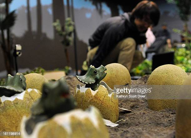 Programer and robotics engineer for KumoTek Masahiro Ishida programs the interactive behavior for the Triceratops and her nest of babies just popping...