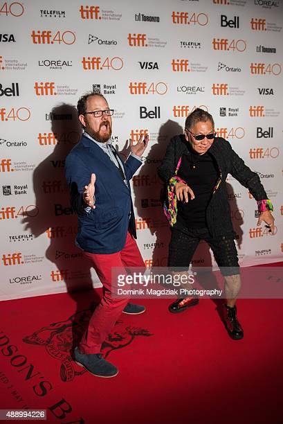 TIFF Programer Colin Geddes and director Takashi Miike attend 'Yakuza Apocalypse' photo call during the 2015 Toronto International Film Festival held...