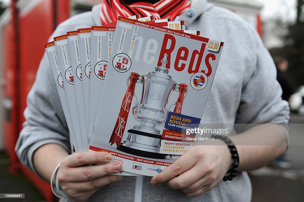 A programme seller displays the match day programme outside the ground during the FA Cup with Budweiser Third Round match between Crawley Town and Reading at Broadfield Stadium on January 5, 2013 in Crawley, West Sussex.