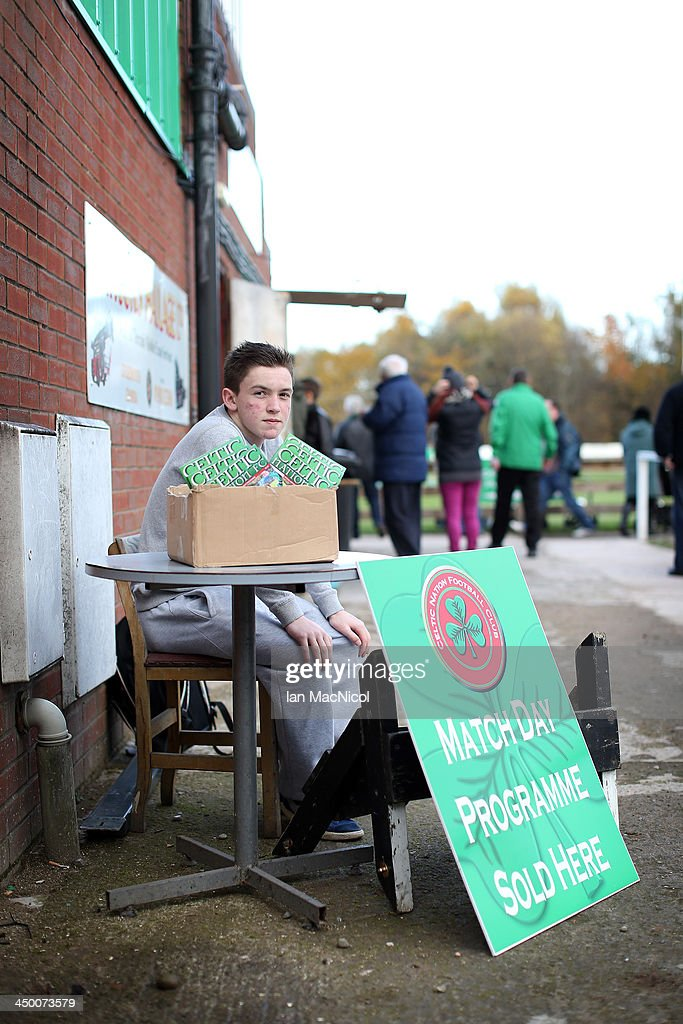 CARLISLE, ENGLAND - NOVEMBER 16 A programme seller inside the stadium during the Ebac Division One football match between Celtic Nation and Hebburn Town on November 16, 2013 at Gillford Park in Carlisle, England.