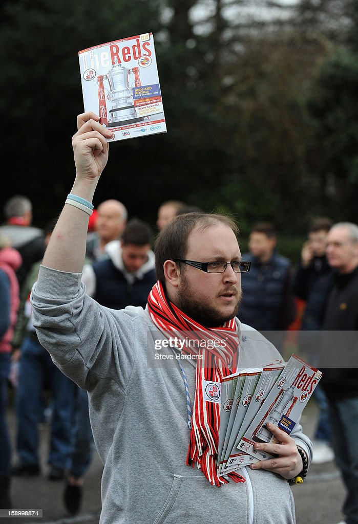A programme seller walks outside the ground during the FA Cup with Budweiser Third Round match between Crawley Town and Reading at Broadfield Stadium on January 5, 2013 in Crawley, West Sussex.