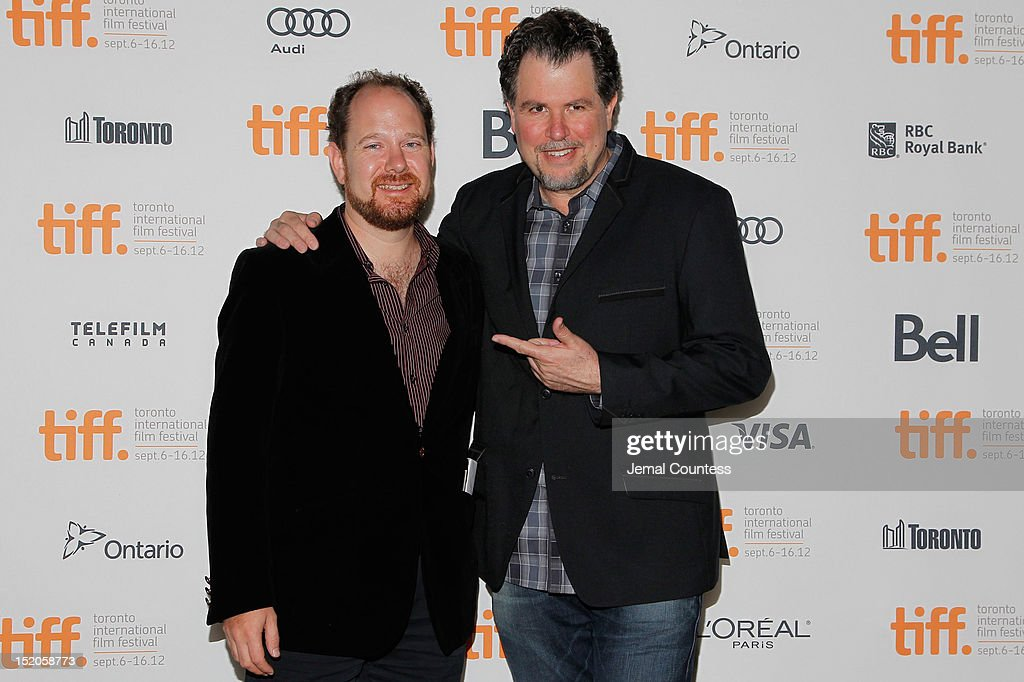 TIFF programmer <a gi-track='captionPersonalityLinkClicked' href=/galleries/search?phrase=Colin+Geddes&family=editorial&specificpeople=4486969 ng-click='$event.stopPropagation()'>Colin Geddes</a> and filmmaker Don Coscarelli attend the 'John Dies At The End' Premiere during the 2012 Toronto International Film Festival held at Ryerson Theatre on September 15, 2012 in Toronto, Canada.