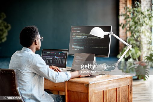 Programmer working with program code : Stock Photo