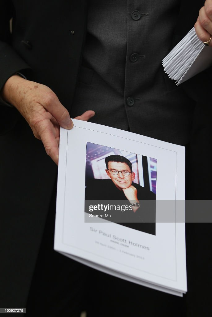 Programmes are handed out as mourners arrive at Auckland Cathedral of the Holy Trinity in Parnell on February 8, 2013 in Auckland, New Zealand. Hundreds gathered to pay their respects to Sir Paul Homes who passed away last Friday after losing his battle with prostate cancer. Holmes' broadcasting career spanned over 40 years on radio and television in New Zealand, Australia, Netherlands and the UK.