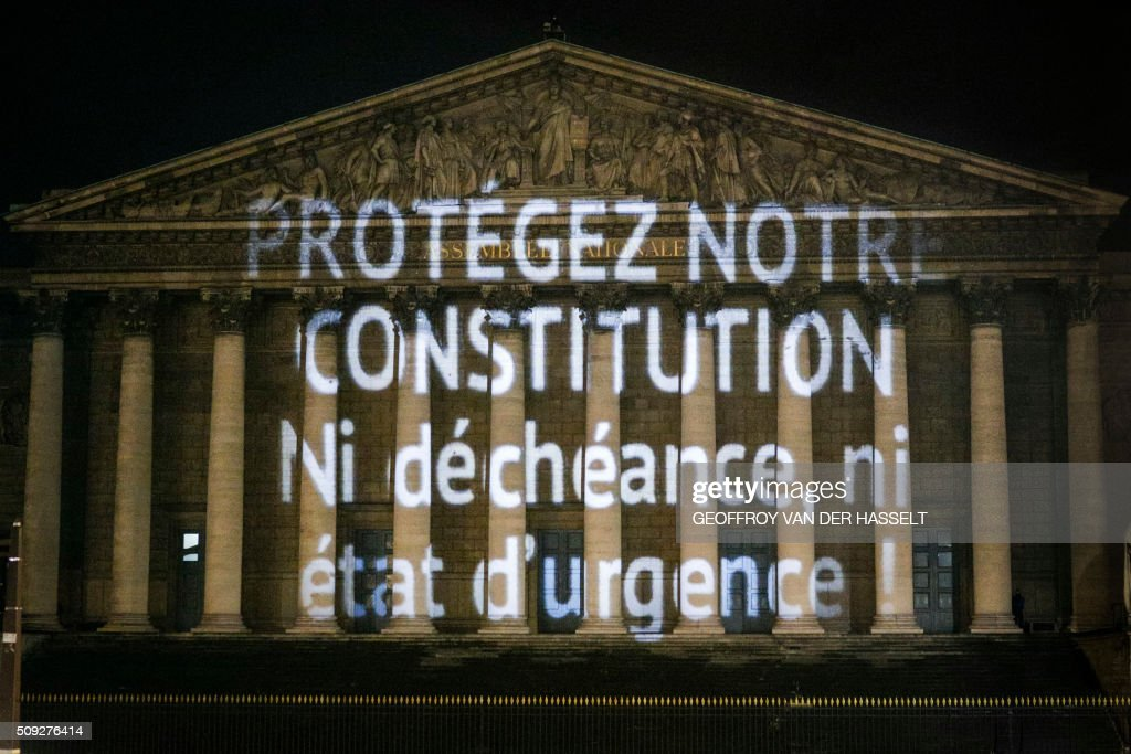 A progressive citizen's movement projects a message on the wall of the Palais Bourbon, French national assembly, on February 9, 2016, to deputies who will meet on February 10 to vote the solemn on the revision of the Constitution. In this picture the message says 'In the name of democracy, do not change the constitution!' / AFP / Geoffroy Van der Hasselt