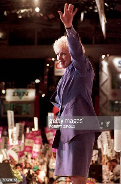 Progressive Conservative Party candidate Kim Campbell waves to supporters 12 June 1993 after her speech to delegates attending the PC's leadership...