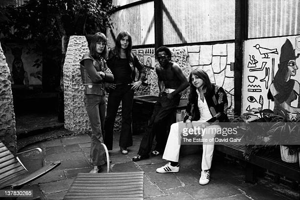 Progressive rock band Emerson Lake and Palmer visit with jazz trumpeter Miles Davis at Davis' home in August 1971 in New York City