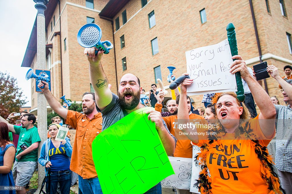 Progun control protestors march at the site of a mock mass shooting close to The University of Texas campus December 12 2015 in Austin Texas In...