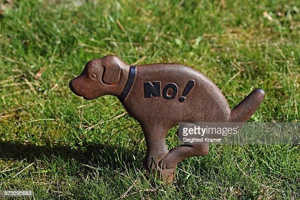 Prohibition sign no to dog waste on lawns