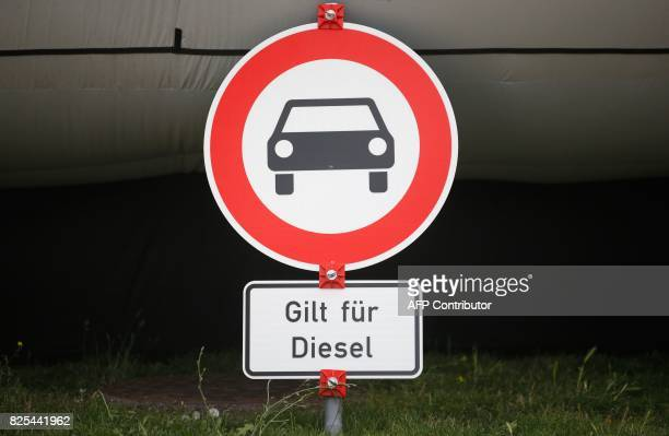 A prohibition sign reading 'valid for diesel' is pictured during a protest of environmental activists on August 2 2017 in front of the German...