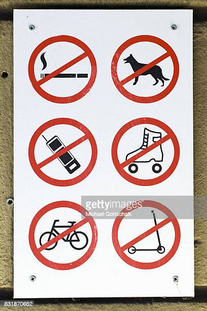 Prohibition signs smoking prohibited dogs forbidden cell phones prohibited roller skating forbidden cycling prohibited scooter prohibited on January...