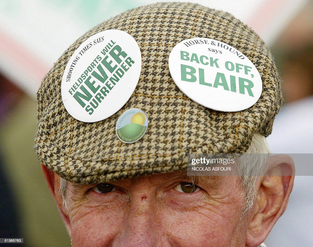 A pro-hunt supporter wears buttons on his hat on the Brighton Pier to protest the Labour Party Conference in Brighton, England, 28 September, 2004. The protesters, lead by the Countryside Alliance, are demonstrating against the an imminent ban on fox-hunting in England and Wales lead by the Labour government.