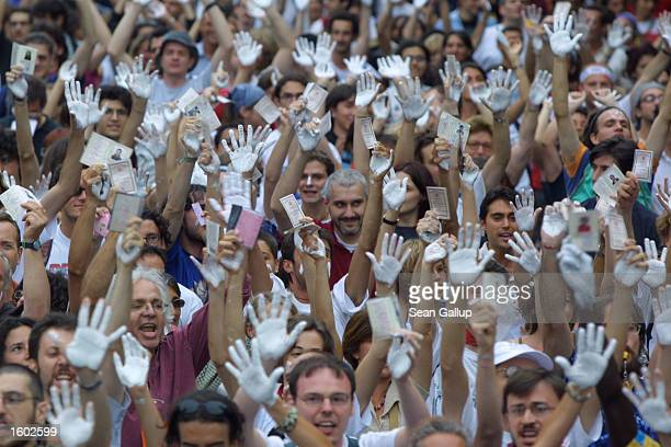 Proimmigration activists with whitestained hands take part in an antiG8 demonstration July 19 2001 in Genoa Italy on the eve of the G8 summit...