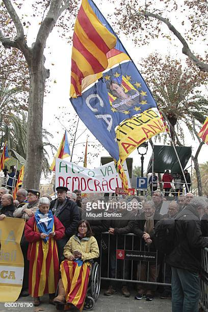Proindependence activists hold 'estelades' Catalan proindependence flags and banners with slogans supporting the President of the Catalan Parliament...