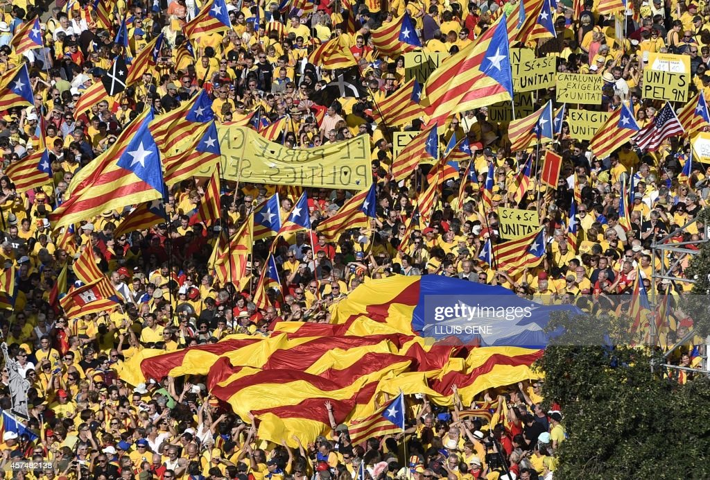 Proindependence Catalans members of Omnium Cultural and National Assembly of Catalonia ACN demonstrate in support of the independence referendum...
