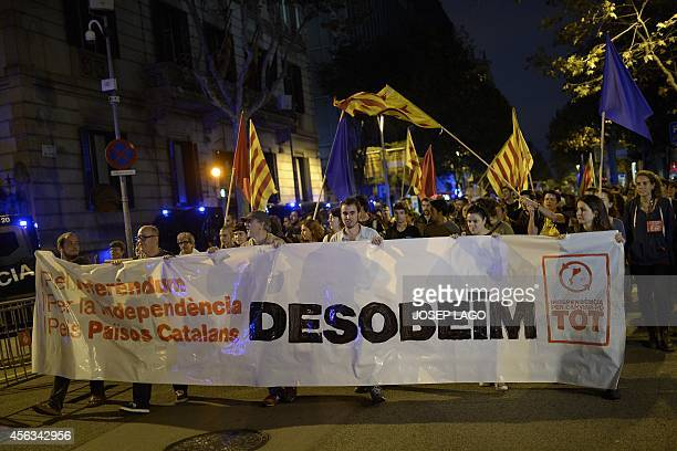 Proindependence Catalans protest in front of a Spanish government delegation in Barcelona on September 29 2014 Spain's Constitutional Court today...