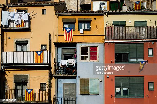 Proindependence flags are seen on balconies on September 24 2015 in Girona Spain Over 5 million Catalans will be voting in Parliamentary elections on...