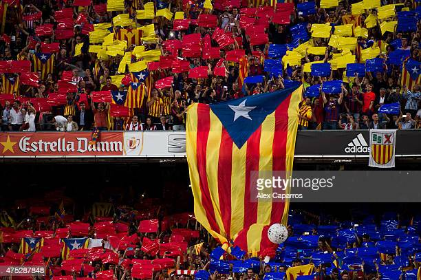 A proindependence of Catalonia flag is shown by supporters of FC Barcelona as Spanish National Anthem is played before the Copa del Rey Final between...