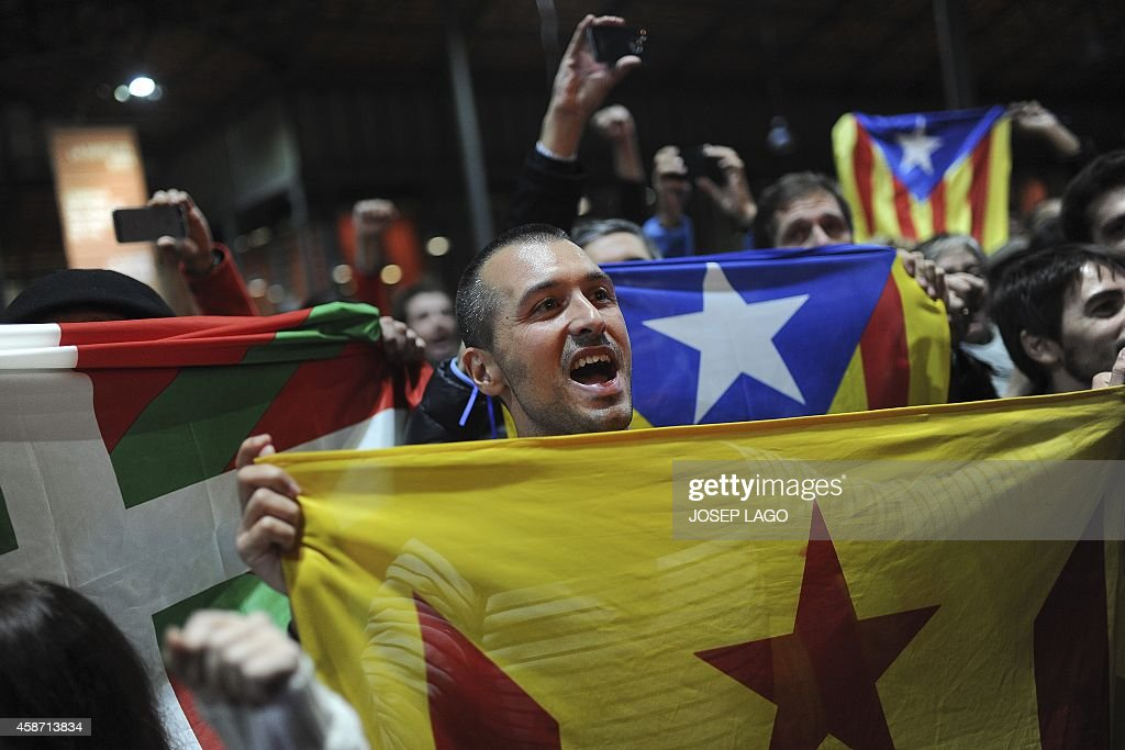 Proindependence people hold a Catalan independence flag during a meeting organised by the Catalonia National Assembly and the Omnium Cultural civil...