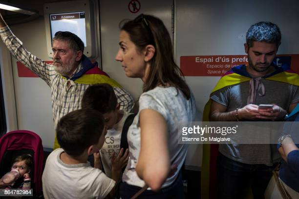 Proindependence protesters take the subway to join the massive crowd that rally to demand the release of imprisoned Catalan leaders Jordi Sanchez and...
