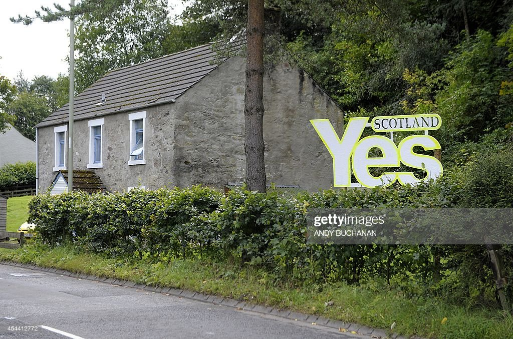 A proindependence sign is displayed outside the Birnam Highland Games in Perthshire Scotland on August 30 2014 Support for Scottish independence is...