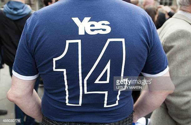 A proindependence supporter displays his shirt during a photocall with Scottish First Minister Alex Salmond and European citizens to celebrate...