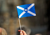 A proindependence supporter holds a 'Yes' flag as Scottish MP Jim Murphy addresses prounion 'Better Together' campaign supporters in Edinburgh on...