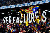 ProIndependence supporters hold up letters that reads 'We will be free' during the La Liga match between FC Barcelona and Celta de Vigo at Camp Nou...