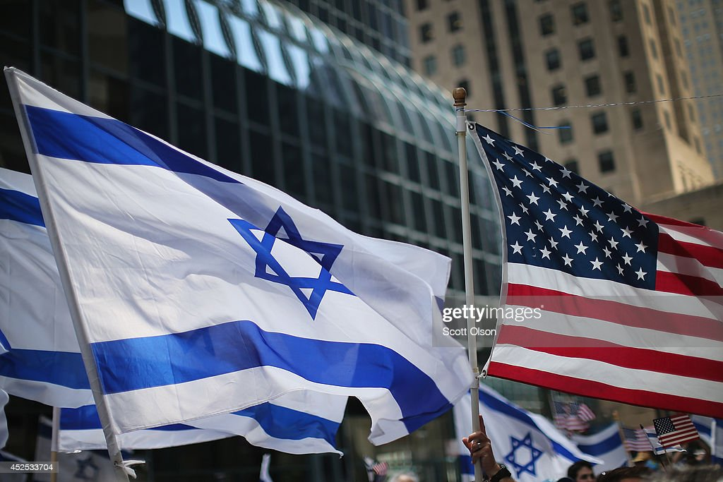 ProIsrael demonstrators wave flags during a rally on July 22 2014 in Chicago Illinois More than 1000 people supporting both sides of the 14dayold...
