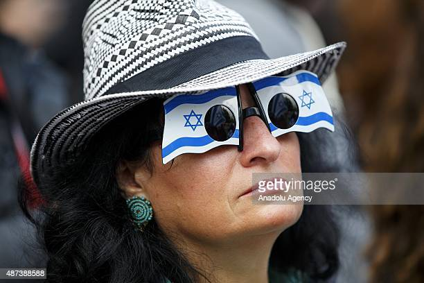 A proIsraeli demonstrator is seen during the pro and antiIsrael demonstrations outside Downing Street in London England ahead of a visit by Israeli...