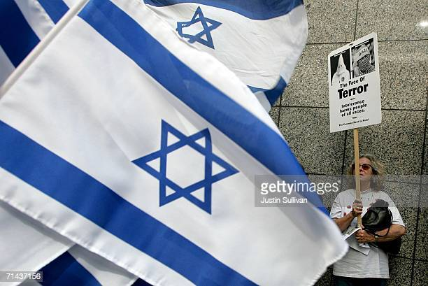 ProIsraeli demonstrators wave flags and carry signs in support of Israel's military offensive against Palestine and Lebanon July 13 2006 in San...
